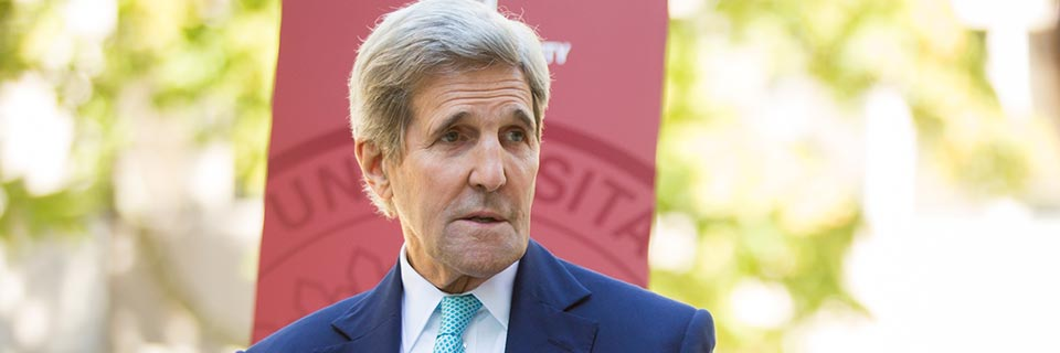 Former U.S. Secretary of State John Kerry gestures as he speaks.